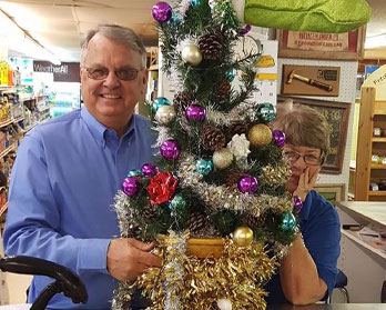 Jim and Beth Ivy with the store's small decorated Christmas Tree at Wallace Lumber Company