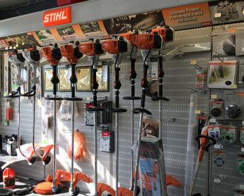 Stihl tools and supplies displayed on wall at Wallace Lumber Company