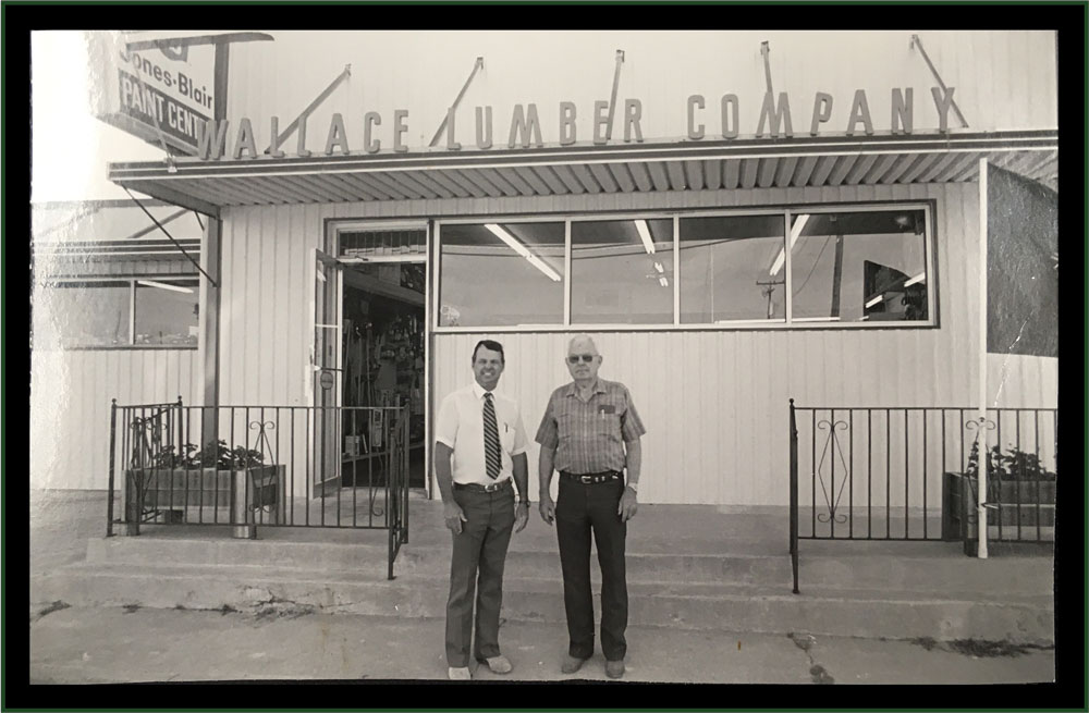 Jim Ivy and A.E. Wallace in front of Wallace Lumber Company.