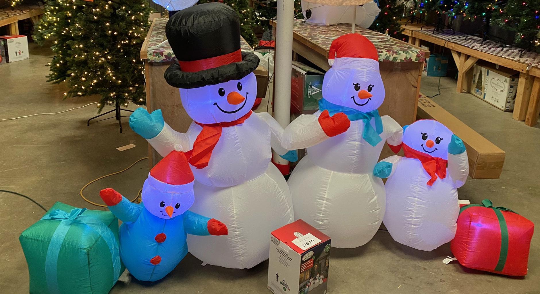 Snowmen blow-up decor at Wallace Lumber Company